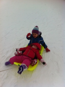 kids first day on snow..very hard for daniella to fall asleep on the sled with big sister dropping snow bombs!
